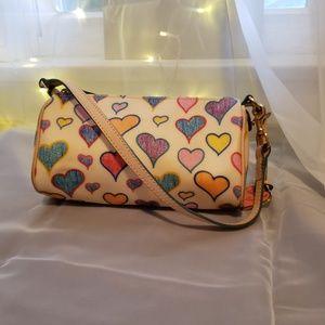 Dooney and Bourke hand bag. Heart print